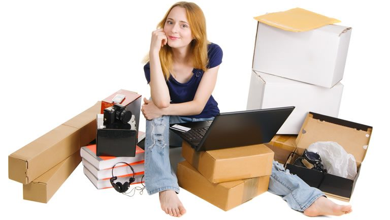 Girl online shopping and sitting with delivered packages